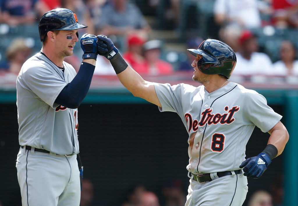 . Detroit Tigers\' Mikie Mahtook (8) celebrates with Grayson Greiner after hitting a solo home run off Cleveland Indians\' Andrew Miller during the eighth inning of a baseball game, Sunday, Sept. 16, 2018, in Cleveland. (AP Photo/Ron Schwane)