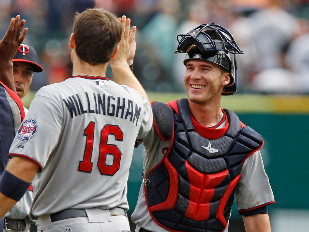 . Twins catcher Chris Herrmann, right, celebrates a 7-6 win over the Tigers with teammate Josh Willingham. Herrmann knocked in what proved to be the winning run in the eighth inning. (AP Photo/Duane Burleson)