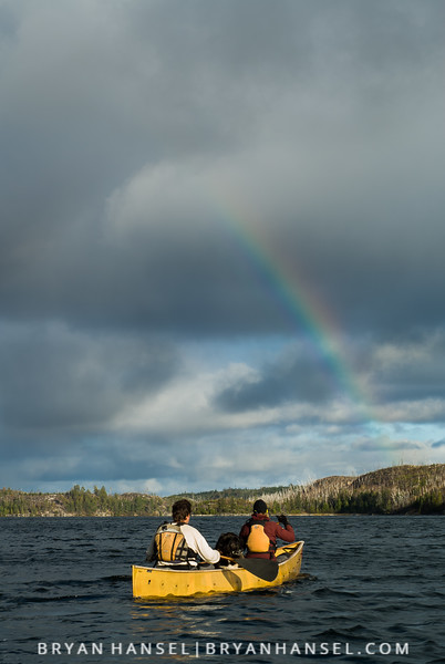 Amy and Dave Freeman paddling under a rainbow on Knife Lake in the BWCA.