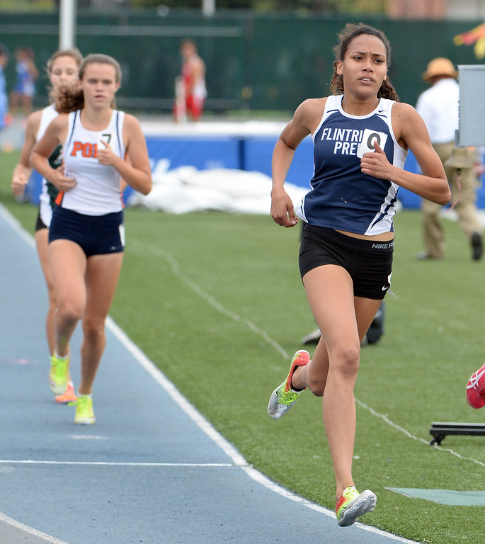 . Flintridge Sarah Yoho competes in the division 4 800 meters race during the CIF Southern Section track and final Championships at Cerritos College in Norwalk, Calif., Saturday, May 24, 2014.   (Keith Birmingham/Pasadena Star-News)