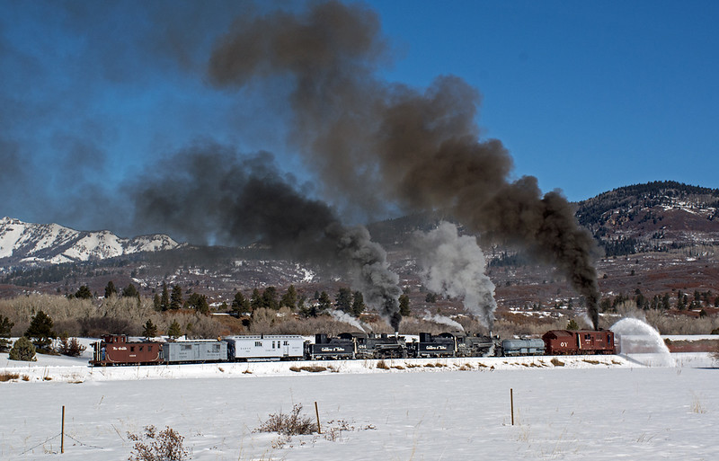February 29, 2020.  The OY and its train heads toward the mountain across the meadow just east of Chama.