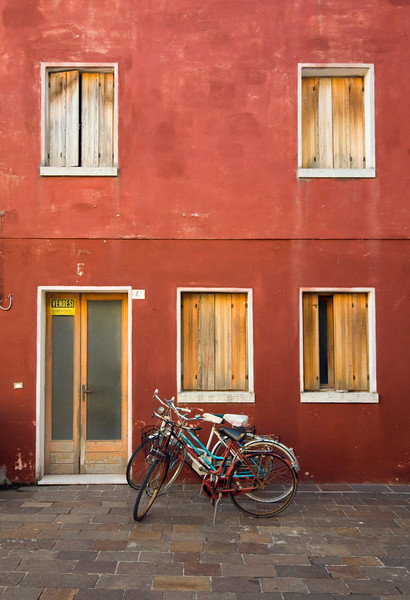 Street Scene with Bicycle and Bright Red House, Historic Center of Caorle, Veneto, Italy