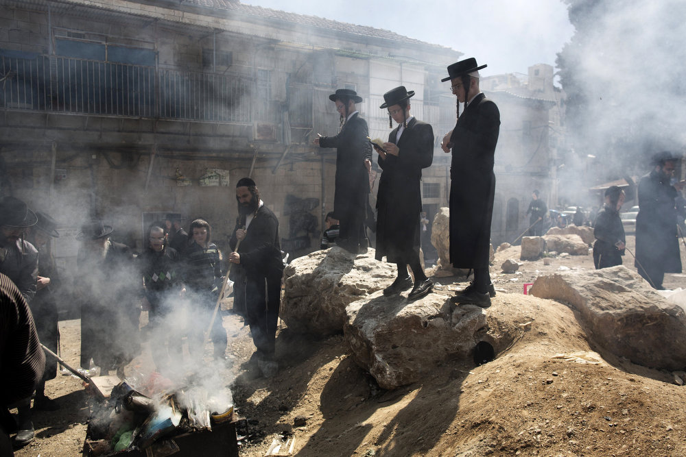 . Ultra-Orthodox Jews pray as they burn leavened items in a final preparation before the start at sundown of the Jewish Pesach (Passover) holiday, on March 25, 2013 in Jerusalem. Religious Jews worldwide eat matzoth during the eight-day Pesach holiday that commemorates the Israelis\' exodus from Egypt some 3,500 years ago and their ancestors\' plight by refraining from eating leavened food products. MENAHEM KAHANA/AFP/Getty Images