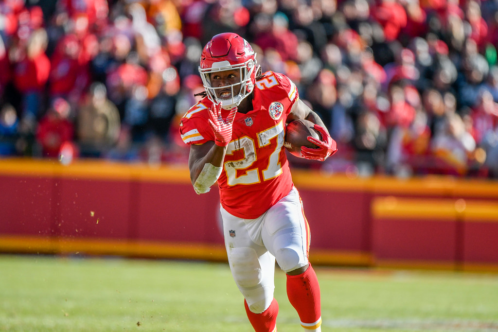 . Kansas City Chiefs running back Kareem Hunt (27) carries the ball during the first half of an NFL football game against the Oakland Raiders in Kansas City, Mo., Sunday, Dec. 10, 2017. (AP Photo/Ed Zurga)