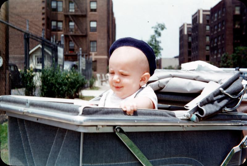 baby richard in pram on benches 1955_.jpg