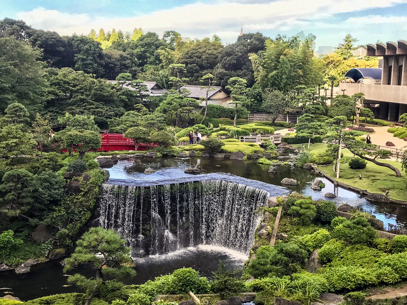 Waterfall in the middle of a green garden at Hotel New Otani, Tokyo, Japan.