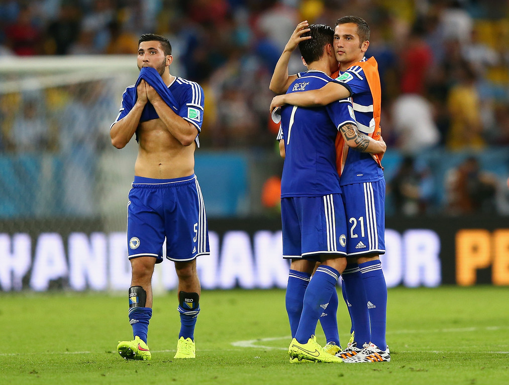 . (L-R) Sead Kolasinac, Muhamed Besic and Anel Hadzic of Bosnia and Herzegovina react after losing to Argentina 2-1 during the 2014 FIFA World Cup Brazil Group F match between Argentina and Bosnia-Herzegovina at Maracana on June 15, 2014 in Rio de Janeiro, Brazil.  (Photo by Jamie Squire/Getty Images)