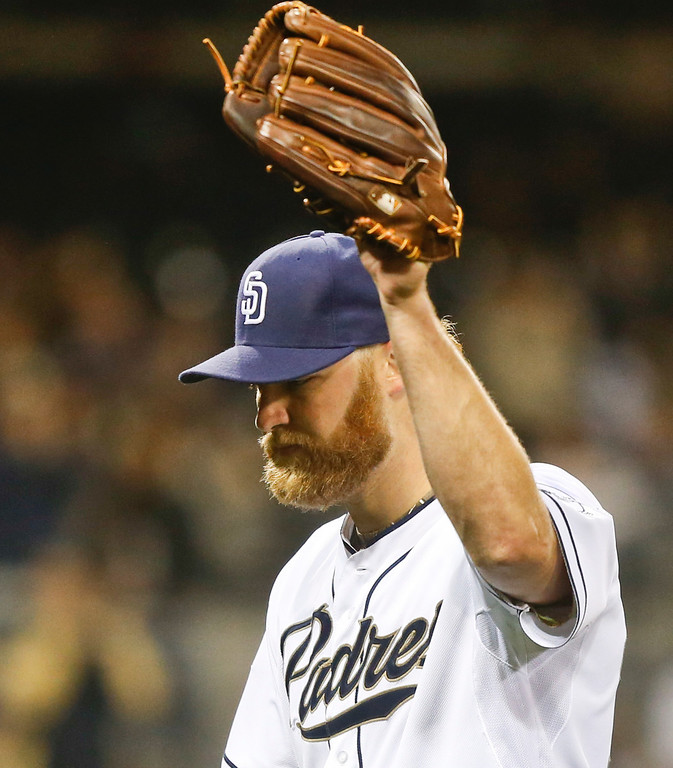 . San Diego Padres starting pitcher Andrew Cashner acknowledges at the standing ovation from the fans as he leaves the game against the Colorado Rockies in the eighth inning of a baseball game Wednesday, April 16, 2014, in San Diego.  Cashner pitched seven and a third innings and allowed two runs while striking out five.   (AP Photo/Lenny Ignelzi)