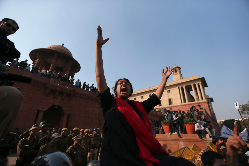 Description of . A demonstrator shouts slogans during a protest rally near the presidential palace in New Delhi December 22, 2012. Indian police used batons, tear gas and water cannon to turn back thousands of people marching on the presidential palace on Saturday in intensifying protests against the gang-rape of a woman on the streets and on social media. REUTERS/Ahmad Masood