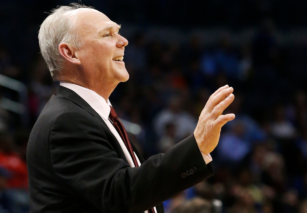 . Denver Nuggets head coach George Karl smiles during the fourth quarter of an NBA basketball game against the Oklahoma City Thunder in Oklahoma City, Tuesday, March 19, 2013. Denver won 114-104. (AP Photo/Sue Ogrocki)