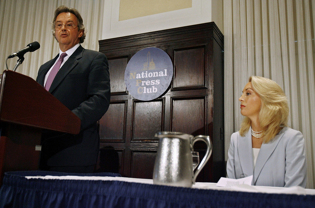 """. WASHINGTON - JULY 14:  Former diplomat Joe Wilson (L), and his wife, retired CIA employee Valerie Plame Wilson hold a press conference where they announced a lawsuit against senior members of the Bush Administration at the National Press Club July 14, 2006 in Washington, DC. Plame filed suit in U.S. District Court July 13, 2006, charging that Vice President Dick Cheney, his aide, I Lewis \""""Scooter\"""" Libby, and presidential advisor Karl Rove destroyed her career when they leaked her identity to the press.  (Photo by Chip Somodevilla/Getty Images)"""