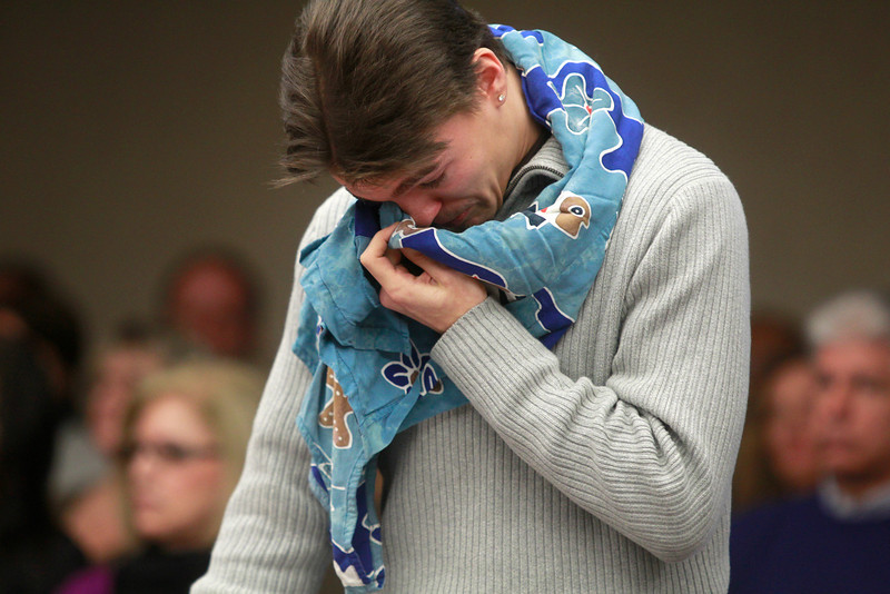 """. Ford Seeman wipes tears from his face with his late mothers dress which he wore around his neck during the sentencing of  Amy Locane Bovenizer on Thursday, Feb. 14, 2013 in Somerville, N.J.   Locane-Bovenizer, the former \""""Melrose Place\"""" actress who was driving drunk when her SUV plowed into a car and killed Helene Seeman,  has been sentenced to three years in prison. Locane-Bovenizer faced up to 10 years in prison after a jury in November convicted her of vehicular homicide in the 2010 death of 60-year-old Seeman in Montgomery Township. The judge lowered the maximum sentence citing the hardship on Locane-Bovenizer\'s two children. One has a medical and mental disability.  Locane-Bovenizer\'s blood-alcohol level was nearly three times the legal limit when the crash occurred.  (AP Photo/The Star-Ledger, Patti Sapone, Pool)"""