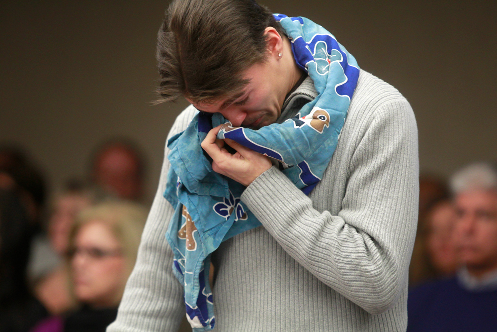 Description of . Ford Seeman wipes tears from his face with his late mothers dress which he wore around his neck during the sentencing of  Amy Locane Bovenizer on Thursday, Feb. 14, 2013 in Somerville, N.J.   Locane-Bovenizer, the former