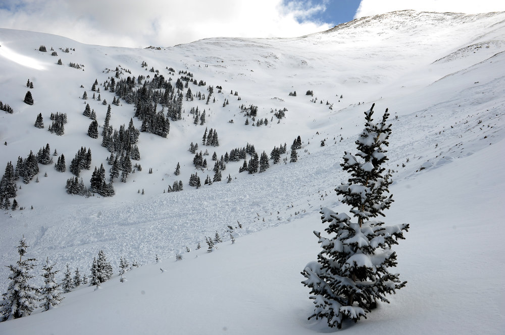 . This is the path the avalanche took.  Members of the Colorado Avalanche Information Center  were on scene investigating the avalanche on April 21, 2013. The avalanche occurred in an area known as  Sheep Creek near Loveland Pass on Saturday, April 20, 2013. The deadly avalanche killed 5 snowboarders.   The avalanche was on the western flank of Mount Sniktau and happened around 2:00 pm on Saturday.  (Photo By Helen H. Richardson/ The Denver Post)