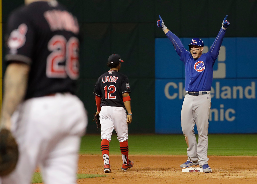 . Chicago Cubs\' Anthony Rizzo reacts after teammate Kris Bryant scored on Rizzo\'s hit during the fifth inning of Game 7 of the Major League Baseball World Series against the Cleveland Indians Wednesday, Nov. 2, 2016, in Cleveland. (AP Photo/David J. Phillip)