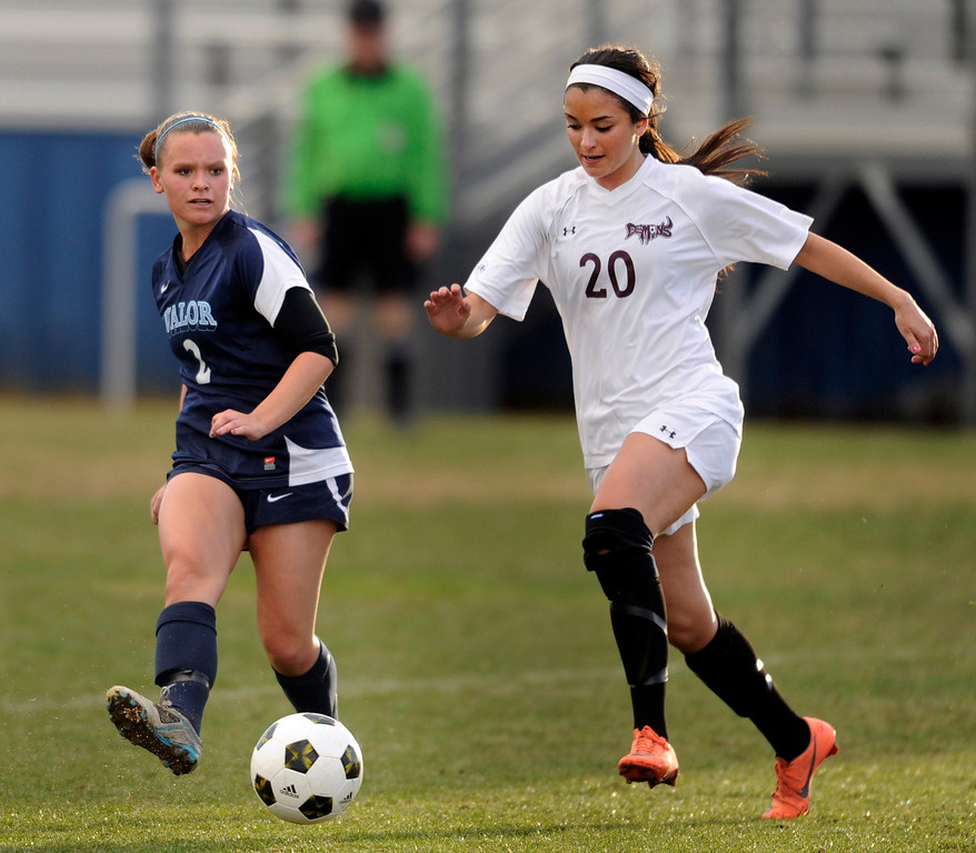 . PARKER, CO. - APRIL 2: Valor senior midfielder Rachael Collins (2) slipped a pass in front of Demons forward Sarah Tasci (20) in the first half. The Valor Christian High School girl\'s soccer team defeated Golden 4-1 Wednesday night, April 3, 2013.  Photo By Karl Gehring/The Denver Post)