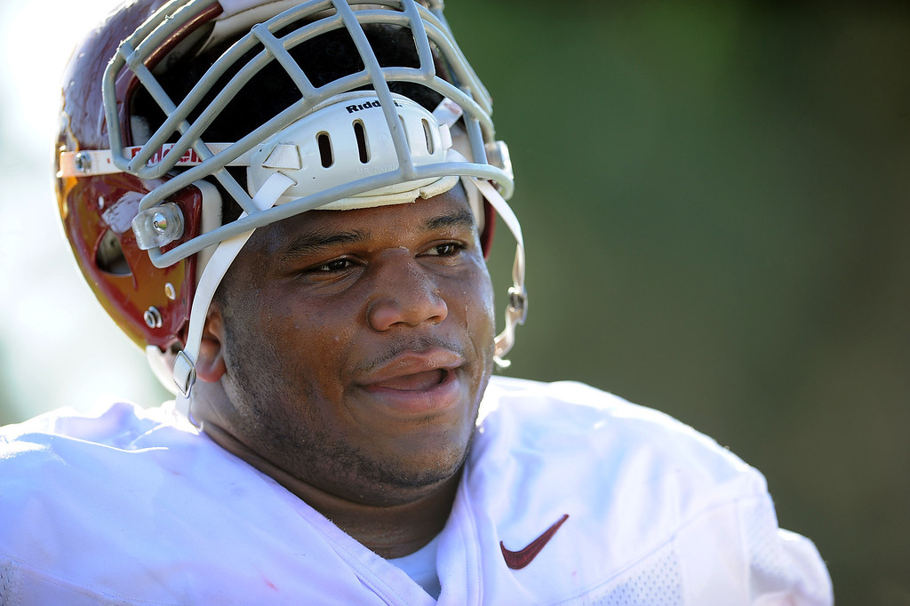 . USC\'s Antwaun Woods takes a break between plays during spring practice at USC Monday, April 1, 2014. (Andy Holzman/Los Angeles Daily News)