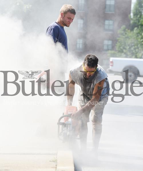 Harold Aughton/Butler Eagle: Concrete workers repair the sidewalks beside Applebees' Wednesday, Sept. 11.