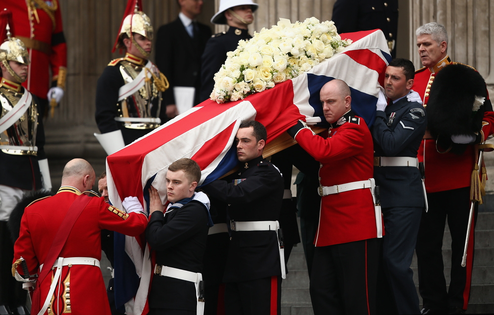 . Members of the Armed Services carry the coffin after the Ceremonial funeral of former British Prime Minister Baroness Thatcher at St Paul\'s Cathedral on April 17, 2013 in London, England. Dignitaries from around the world today join Queen Elizabeth II and Prince Philip, Duke of Edinburgh as the United Kingdom pays tribute to former Prime Minister Baroness Thatcher during a Ceremonial funeral with military honours at St Paul\'s Cathedral. Lady Thatcher, who died last week, was the first British female Prime Minister and served from 1979 to 1990.  (Photo by Dan Kitwood/Getty Images)