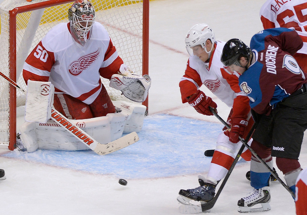 . Colorado Avalanche center Matt Duchene (9) battles with Detroit Red Wings center Joakim Andersson (18) for the puck as it bounces in front of Detroit Red Wings goalie Jonas Gustavsson (50) during the third period October 17, 2013 at Pepsi Center.(Photo by John Leyba/The Denver Post)