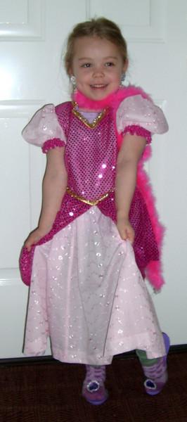 Modeling her Sleeping Beauty dress (made by Grandmama Carol).