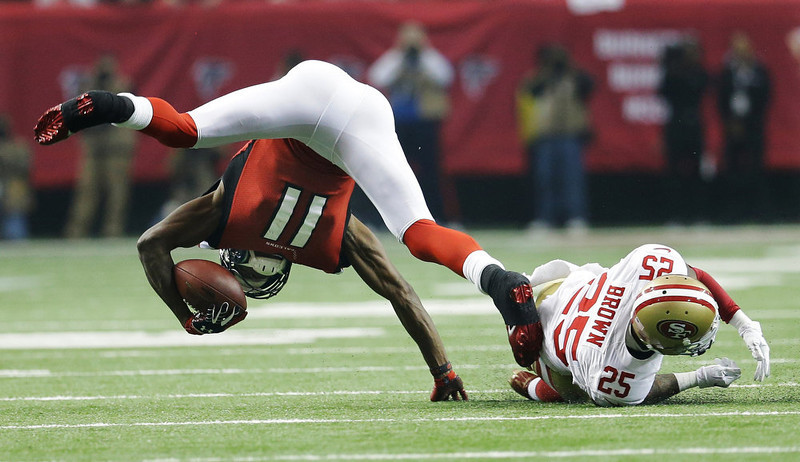 . Atlanta Falcons\' Julio Jones (11) catches a pass in front of San Francisco 49ers\' Tarell Brown (25) during the first half of the NFL football NFC Championship game Sunday, Jan. 20, 2013, in Atlanta. (AP Photo/Mark Humphrey)