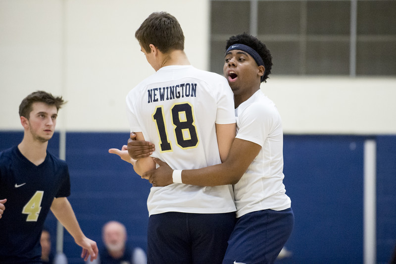 05/13/19  Wesley Bunnell | Staff  Newington boys volleyball vs Westfield MA on Monday night at Newington High School. Louis Egbuna (2) hugs Teddy Fravel (18) after a point.