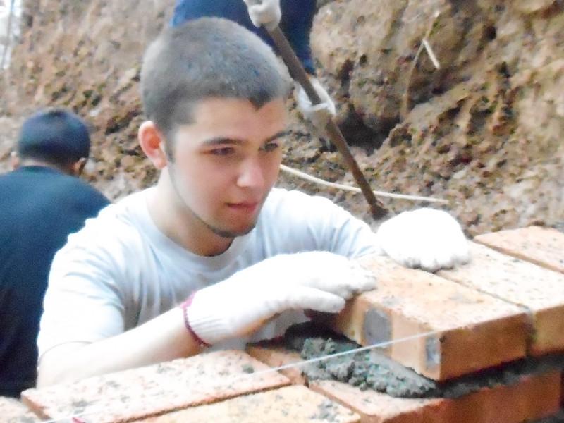 jonathan lining up a brick