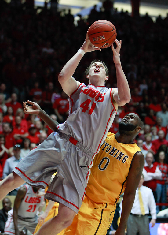 . New Mexico\'s Cameron Bairstow shoots with Wyoming\'s Leonard Wahington behind him during the first half of an NCAA college basketball game in Albuquerque, N.M., Saturday, March 2, 2013. (AP Photo/Craig Fritz)