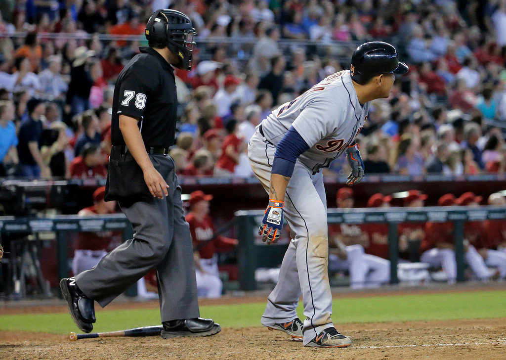 . Detroit Tigers\' Miguel Cabrera and home plate umpire Manny Gonzalez (79) watch Cabrera\'s three-run home run stay fair against the Arizona Diamondbacks during the eighth inning of a baseball game, Wednesday, July 23, 2014, in Phoenix. (AP Photo/Matt York)