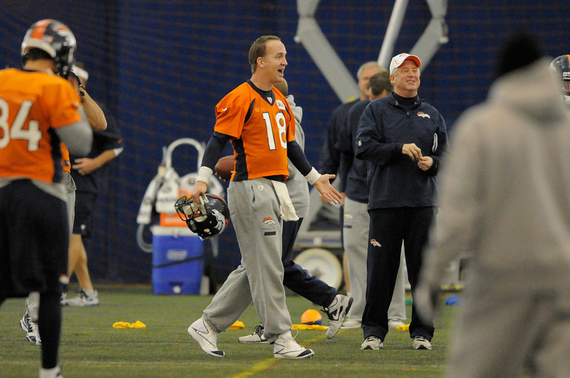 . Denver Broncos head coach John Fox and Denver Broncos quarterback Peyton Manning (18) smiles during practice Wednesday, December 19, 2012 at Dove Valley as they prepare for the Cleveland Browns.  John Leyba, The Denver Post