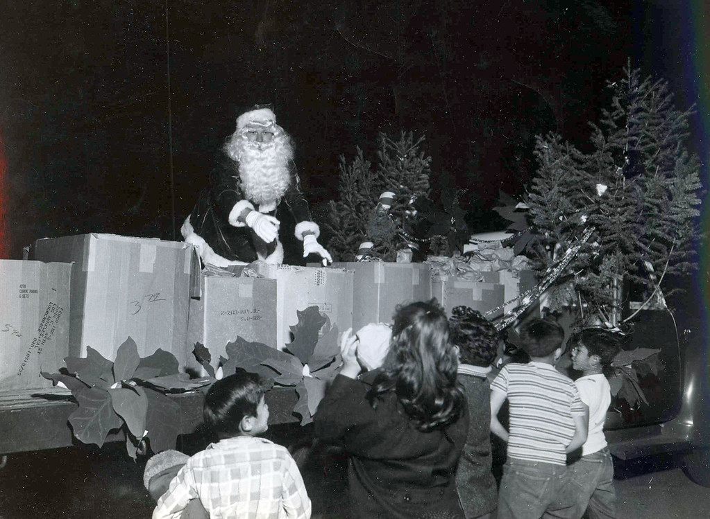 . SAN BERNARDINO -- The Ho Ho Parade was a big deal during the holidays, with its roots traced back to the 1950s. Photos like these through the years show a first-responder community in San Bernardino annually bringing Christmas cheer to the city\'s neighborhoods. The event was canceled this year. (Courtesy)