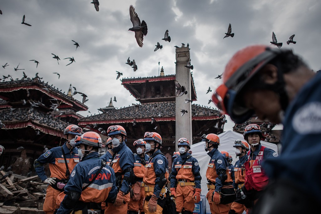 . Rescuers from Japan are seen in the historical centre of Kathmandu on April 29, 2015, following a 7.8 magnitude earthquake which struck the Himalayan nation on April 25.  Rescuers are facing a race against time  to find survivors of a mammoth earthquake that killed more than 5,000 people when it through Nepal five days ago and devastated large parts of one of Asia\'s poorest nations.  AFP PHOTO/Philippe  LOPEZ/AFP/Getty Images