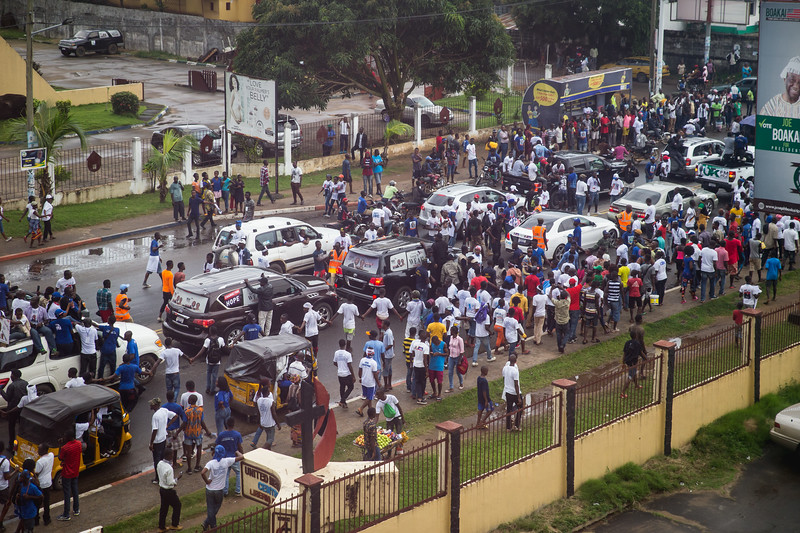 Monrovia, Liberia October 6, 2017 - Presidential candidate George Weah makes his way through traffic in the days leading up to the election.