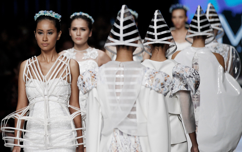 . Models display creations by Indonesian designer Daniella Grace and M.V.Lydia during the Jakarta Fashion Week in Jakarta, Indonesia, Monday, Oct. 21, 2013. (AP Photo/Achmad Ibrahim)
