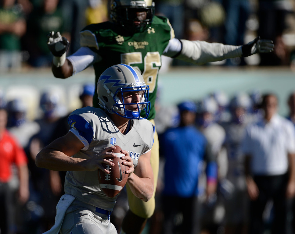 . Air Force QB, Nate Romine, gets pressure from Colorado State LB, Shaquil Barrett, at Hughes Stadium Saturday afternoon, November 30, 2013. The Rams won 58-13. (Photo By Andy Cross/The Denver Post)