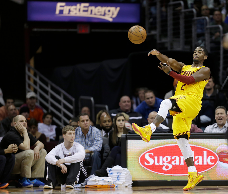 . Cleveland Cavaliers\' Kyrie Irving passes the ball during an NBA basketball game against the New York Knicks Monday, March 4, 2013, in Cleveland. (AP Photo/Tony Dejak)