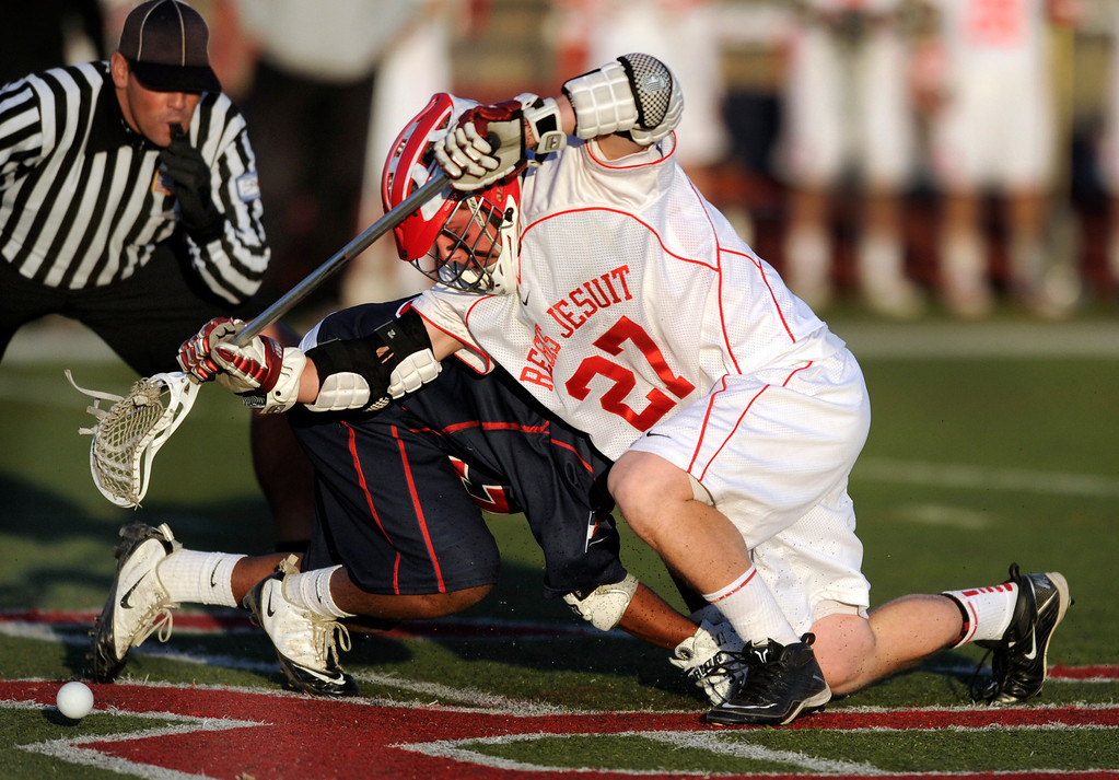 . AURORA, CO. - APRIL 24:  Regis Jesuit freshman Alec Barnes (27) worked the opening face-off Wednesday night. The Regis Jesuit High School boy\'s lacrosse team defeated Kent Denver 10-8 Wednesday night, April 24, 2013. Photo By Karl Gehring/The Denver Post