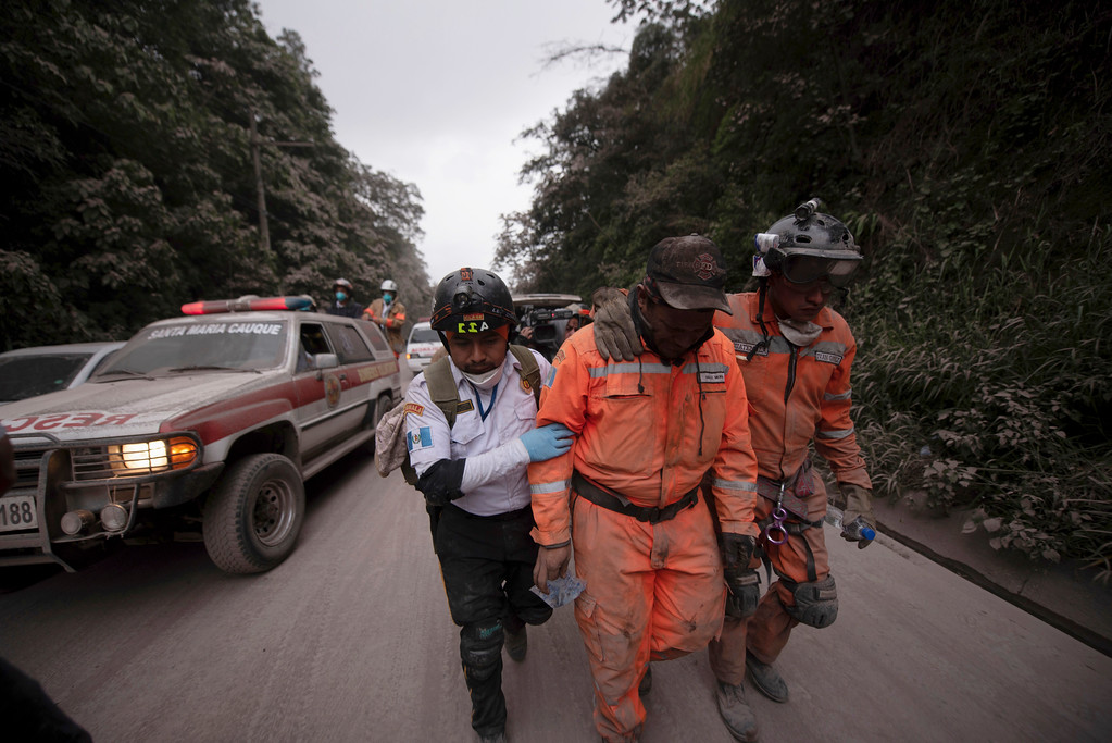 . Firefighters leave the evacuation area near Volcan de Fuego, or Volcano of Fire, in El Rodeo, Guatemala, Sunday, June 3, 2018. One of Central America\'s most active volcanos erupted in fiery explosions of ash and molten rock Sunday, killing people and injuring many others while a towering cloud of smoke blanketed nearby villages in heavy ash. (AP Photo/Santiago Billy)