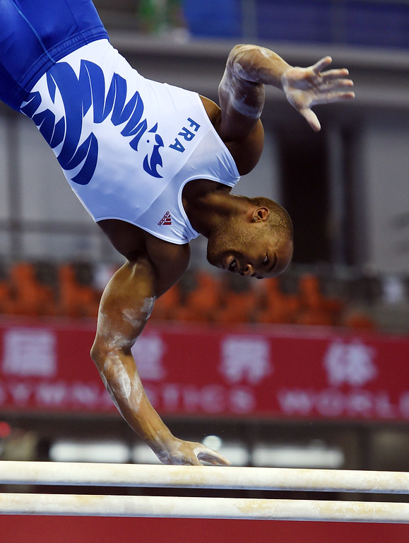 . Axel Augis of France competes on the parallel bars during the men\'s qualification at the Gymnastics World Championships in Nanning, in China\'s southern Guangxi province on October 4, 2014.GREG BAKER/AFP/Getty Images