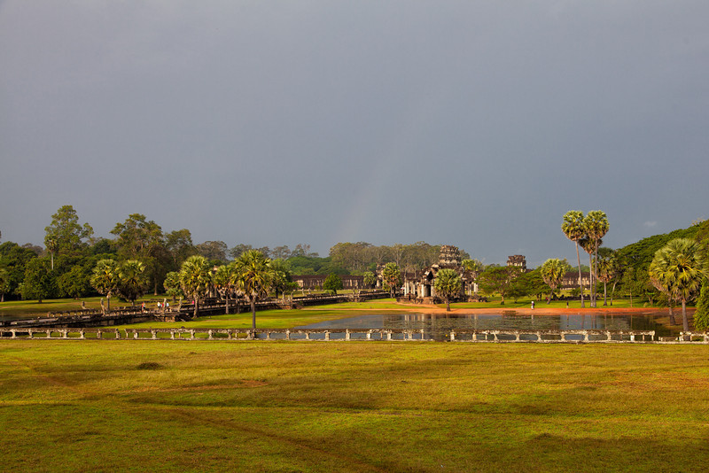A view from the outer wall of Angkor Wat down the walkway, toward the entry tower. You can still see a slight rainbow left behind from the morning rain.