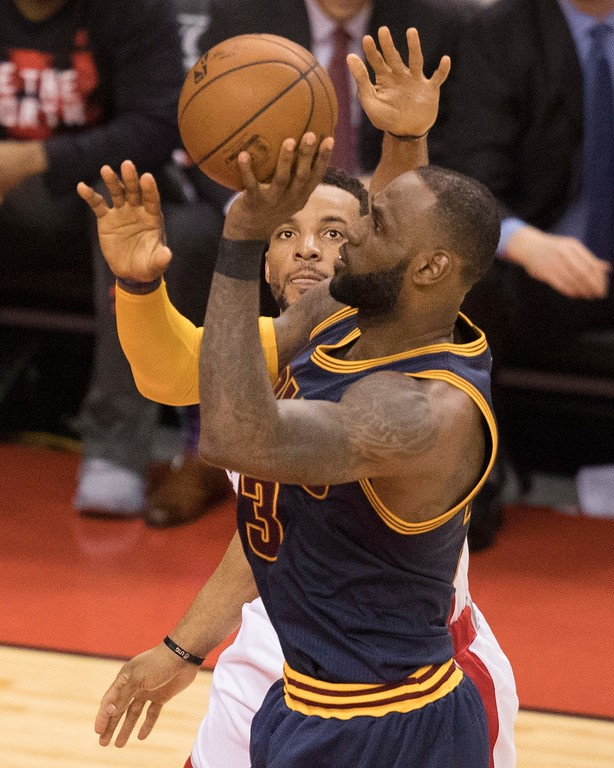 . Cleveland Cavaliers\' LeBron James shoots past Toronto Raptors\' Norman Powell during the second half of Game 3 of an NBA basketball second-round playoff series in Toronto on Friday, May 5, 2017. (Fred Thornhill/The Canadian Press via AP)