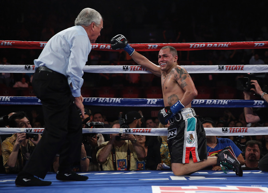 . INGLEWOOD, CA - MAY 17:  Mike Alvarado is knocked down against Juan Manuel Marquez at The Forum on May 17, 2014 in Inglewood, California.  (Photo by Jeff Gross/Getty Images)