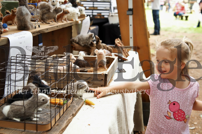Mava Cagwin,3,  points to her favorite needle-felted wool animal from Linda Musko's booth at Whispering Pines Saturday. Seb Foltz/ Butler Eagle