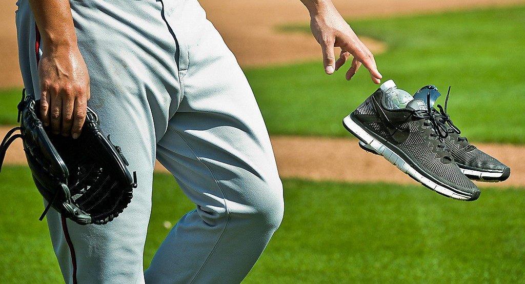 . Nolasco ditches his running shoes before taking the mound. (Pioneer Press: Ben Garvin)
