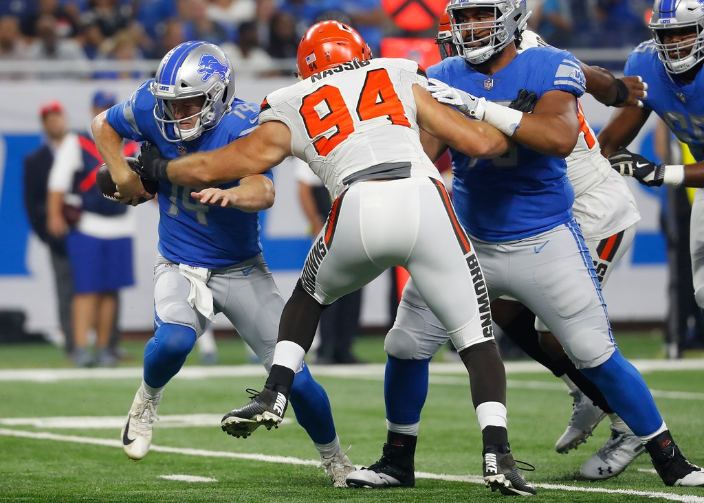 . Cleveland Browns defensive end Carl Nassib (94) knocks the ball away from Detroit Lions quarterback Jake Rudock (14) during the first half of an NFL football preseason game, Thursday, Aug. 30, 2018, in Detroit. (AP Photo/Paul Sancya)