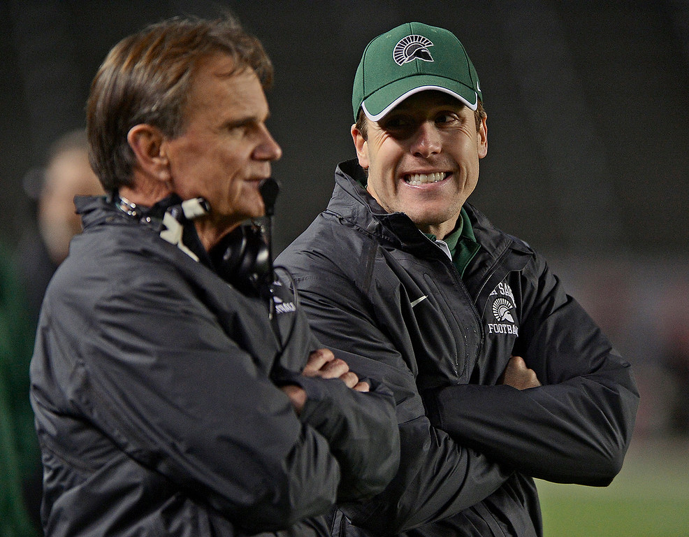 . De La Salle Spartans\' assistant coach Justin Alumbaugh smiles at head coach Bob Ladouceur as they play the Centennial Huskies in the fourth quarter in the Open Division during the 2012 CIF State Football Championship at Home Depot Center in Carson , Calif. on Saturday, Dec. 15, 2012. De La Salle defeated Centennial 48-28. (Jose Carlos Fajardo/Staff)