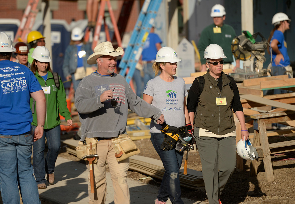 . DENVER, CO - OCTOBER 09: Garth Brooks and Trisha Yearwood work on building a home during Habitat for Humanity\'s Carter Work Project event in the Globeville Neighborhood in Denver, October 09, 2013. The Humanity\'s Carter Work Project will complete 11 new townhouses. (Photo By RJ Sangosti/The Denver Post)