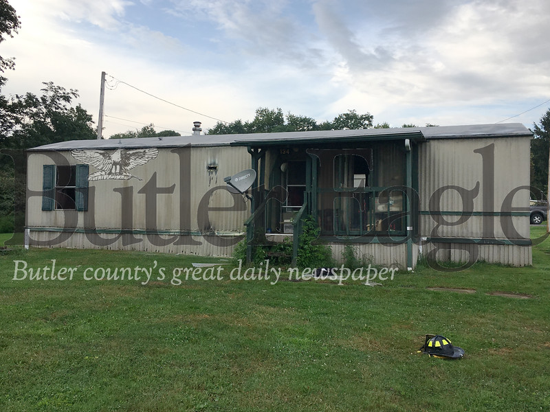 Two dogs  had to be revived after a fire started in a cabinet in a trailer home on Webb Road. Photos by Lauryn Halahurich