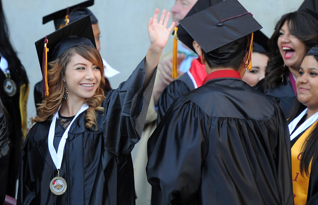 . A student waves to family and friends during the Vail High School commencement at Vail High School on Tuesday, June 18, 2013 in Montebello, Calif.